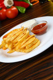 French fries. Crunchy French Fries with sauces on plate Royalty Free Stock Image
