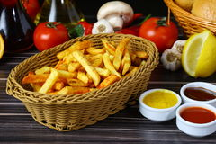 French fries. Crunchy French Fries with sauces on plate Stock Image
