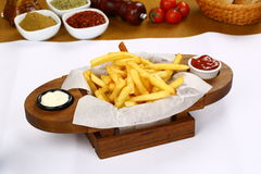 French fries. Crunchy French Fries with sauces on plate Royalty Free Stock Photography