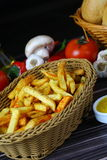 French fries. Crunchy French Fries with sauces on plate Royalty Free Stock Images