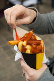 French fries and curry sauce Stock Photo