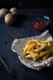 French fries on dark background Royalty Free Stock Photography