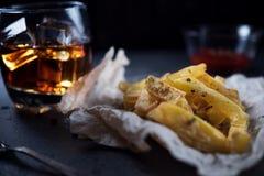 French fries on dark background Stock Photo