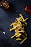 French fries on dark background Royalty Free Stock Images