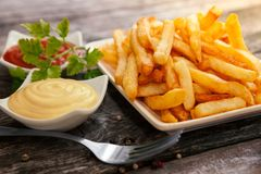 French fries for dinner. With tomato sauce and mayonnaise Stock Photography