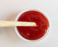 French fries dipped tomato sauce. Royalty Free Stock Photo