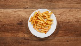 French fries disappear from a slowly rotating plate stock footage
