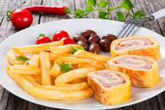 French fries on dish with baked cheese meat Roll-Ups Royalty Free Stock Photos