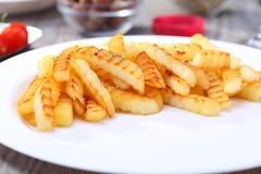 French fries on the dish. Fried french fries on the dish and food background Royalty Free Stock Images