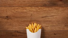 French fries falling into and pouring out of paper holder stock video footage