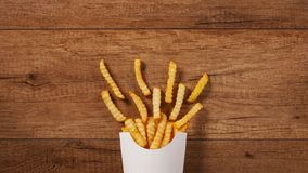 French fries filling a paper holder bag stock video footage