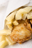 French fries and fish in a white bag Stock Image