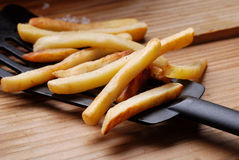 French fries in the foreground Stock Photography