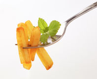 French fries on a fork Royalty Free Stock Photos