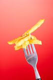 French fries and fork Royalty Free Stock Image