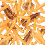 French fries in freeze motion. French fries with chicken strips in freeze motion isolated on white royalty free stock image