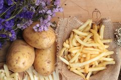 French fries and fresh potatoes sliced.  Stock Image