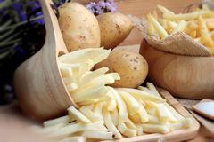 French fries and fresh potatoes sliced Royalty Free Stock Photos