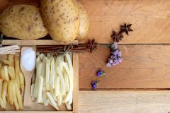 French fries and fresh potatoes sliced.  Stock Images
