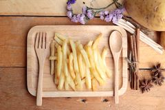 French fries and fresh potatoes sliced Stock Image