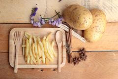 French fries and fresh potatoes sliced.  Royalty Free Stock Image