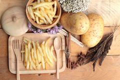 French fries and fresh potatoes sliced.  Royalty Free Stock Photography