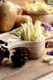 French fries and fresh potatoes sliced Royalty Free Stock Photo