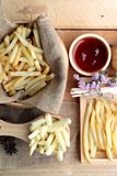 French fries and fresh sliced potatoes with ketchup. French fries and fresh sliced potatoes with ketchup Royalty Free Stock Photo