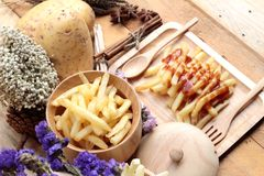 French fries and fresh sliced potatoes with ketchup. French fries and fresh sliced potatoes with ketchup Stock Images