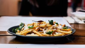 French fries with fried basil, Thai chili and feta cheese Thai fusion food.  stock photography