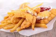 French fries and fried chicken Royalty Free Stock Image