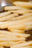 French fries fried in hot oil Royalty Free Stock Photography