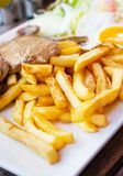 French fries and fried meat. Royalty Free Stock Photography