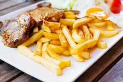 French fries and fried meat. Royalty Free Stock Photos