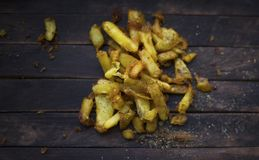 Fried potatoes with spices. French fries fried in vegetable oil and sprinkled with spices stock photography