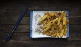 Fried potatoes with spices. French fries fried in vegetable oil and sprinkled with spices stock photos