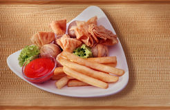 French fries and fried wanton Stock Image