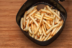 French fries in fryer Stock Image