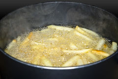 French fries frying Royalty Free Stock Photos