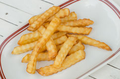 French Fries. Golden French fries potatoes ready to be eaten Royalty Free Stock Photo