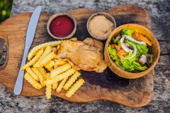 French fries, green salad with champignons and chicken breast. Lifestyle food royalty free stock photos