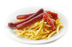 French fries and grilled sausages Stock Image