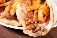 French fries and gyros. Close up to gyros pita Royalty Free Stock Photos