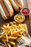 French fries and hot dogs Royalty Free Stock Images