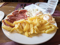 French fries iberian ham and eggs Stock Images