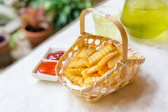 French Fries In Bamboo Basket Royalty Free Stock Photos