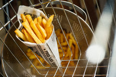 French fries in an iron grid royalty free stock photography