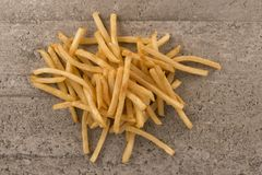 French fries isolated on concrete background. stock photo