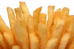 French fries isolated on white. Close up of golden french fries or fried potatoes isolated on white background. Fast Food Collection royalty free stock photos