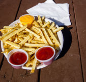 French fries with ketchup and cheese Royalty Free Stock Photography